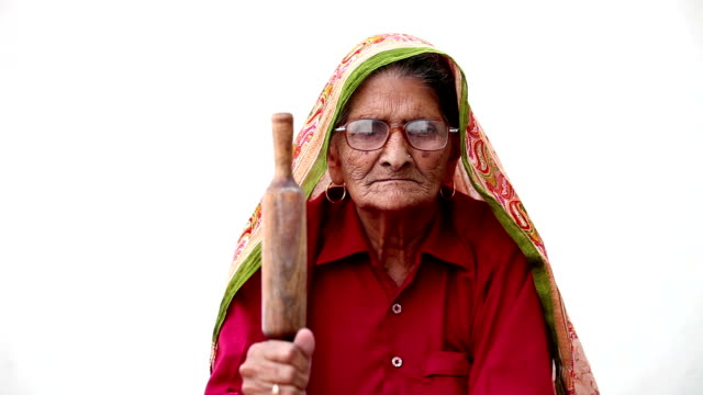 angry grandmother holding chapati roller - senior women stock videos & royalty-free footage