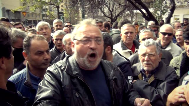 Angry Greek farmers battled with riot police in Athens after storming Agriculture Ministry then paraded their tractors outside parliament on Friday...