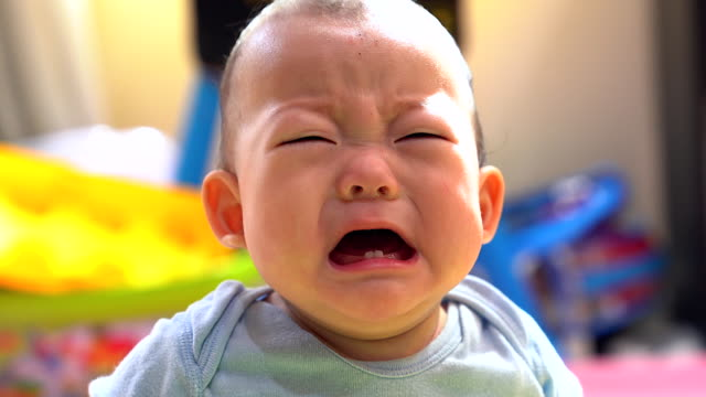 angry little baby with sad expressions, screaming and crying. - crying stock videos & royalty-free footage