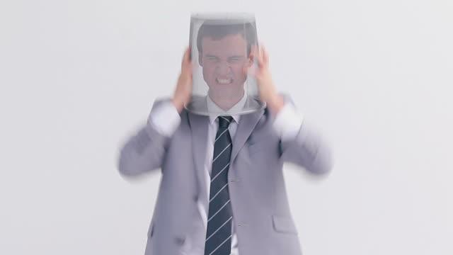 angry man placing a bin on his head - solo un uomo di età media video stock e b–roll