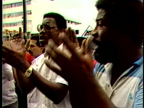 stockvideo's en b-roll-footage met angry manuel noriega loyalists chant unity as armored personnel vehicles carry arrested telecommunications union leaders away - demonstrant
