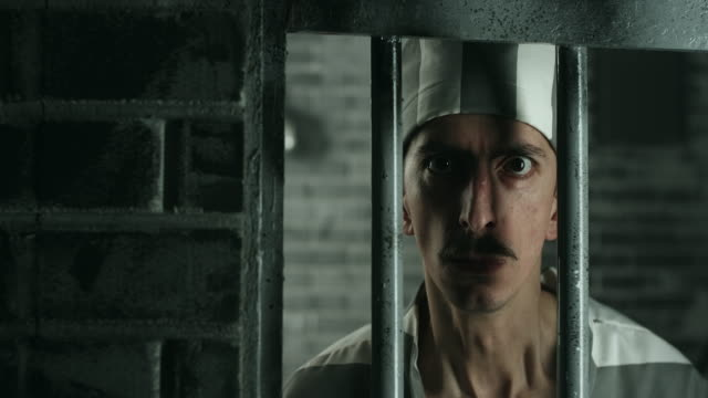 angry men looking at camera from prison cell - claustrophobia stock videos & royalty-free footage