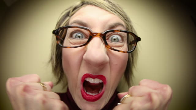 angry middle aged nerdy woman - furious stock videos & royalty-free footage