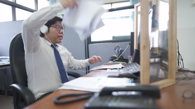 angry office man have a meeting online before throwing documents - annoying colleague stock videos & royalty-free footage