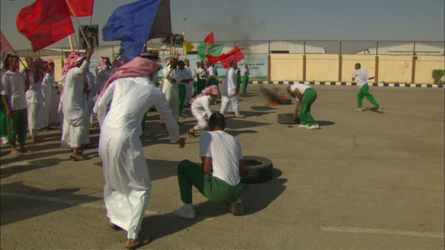 Angry protestors clash with soldiers on a military base in Saudi Arabia.