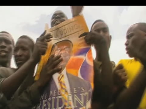 angry protestors hold poster of opposition leader raila odinga in protest against presidential election results kenya 16 january 2009 - poster stock videos & royalty-free footage