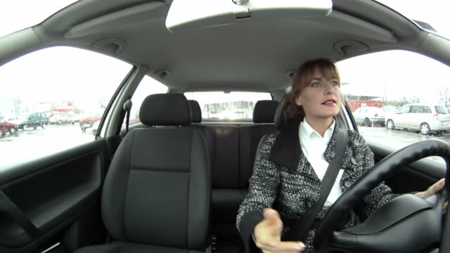 hd: angry woman driving - parking stock videos & royalty-free footage