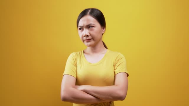 angry woman look at camera over isolated yellow background - plain background stock videos & royalty-free footage