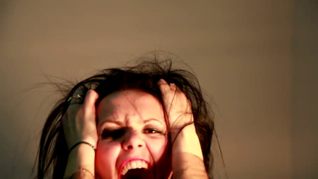 angry woman screaming and rending her hair in agony - windswept stock videos & royalty-free footage