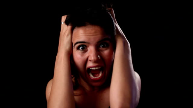 stockvideo's en b-roll-footage met angry young woman going crazy and shouting - schreeuwen