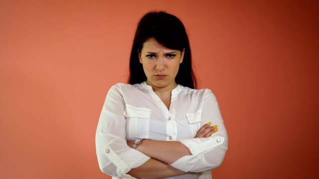 angry young woman standing isolated over pink background. looking camera - disgust stock videos & royalty-free footage