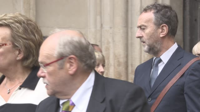 angus deayton leaving at a service of thanksgiving for the life and work of sir terry wogan at westminster abbey on september 27, 2016 in london,... - テリー ウォーガン点の映像素材/bロール