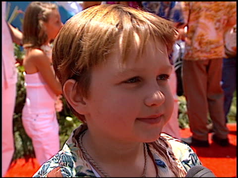 angus t jones at the 'lilo and stitch' premiere at the el capitan theatre in hollywood, california on june 16, 2002. - el capitan theatre stock videos & royalty-free footage