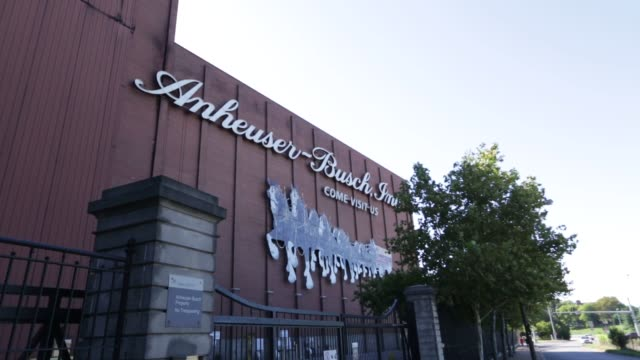 anheuser busch completes its 103 billion dollar deal for sabmiller allowing it to control over a third of the beer market broll of headquarters - anheuser busch inbev stock-videos und b-roll-filmmaterial