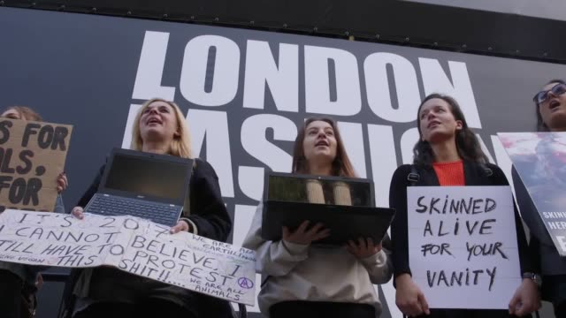 animal rights protesters staged a demonstration outside london fashion week on it'e opening day they were campaigning against the use of fur and in... - week stock videos and b-roll footage