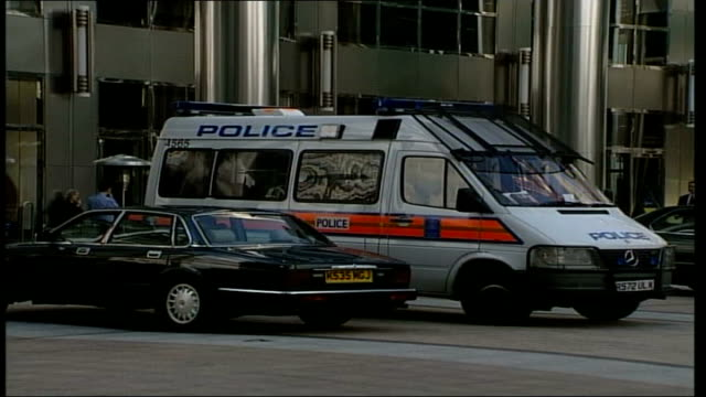 animal rights protestors occupy bank of new york offices; itn england: london: canary wharf: ext gv police van parked outside canary wharf tower,... - london docklands stock videos & royalty-free footage