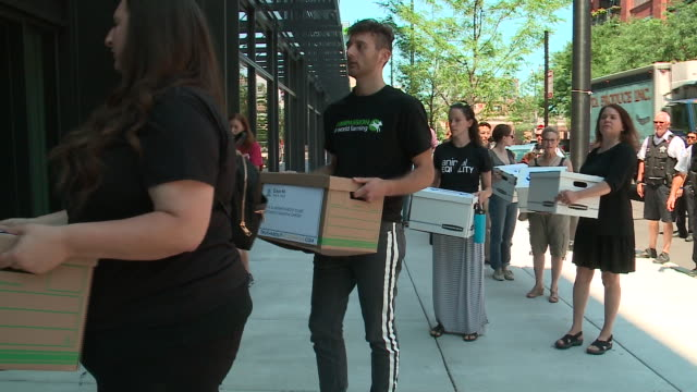 wgn animal welfare advocates protested on july 24 outside mcdonald's new headquarters in chicago's west loop where they delivered a petition with... - petition stock videos & royalty-free footage