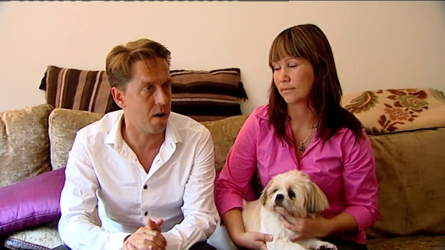 Berkshire couple forced to leave their dog in quarantine in France INT Close up of Dorota stroking Buzz Matt Roberts interview SOT Close up of hands...