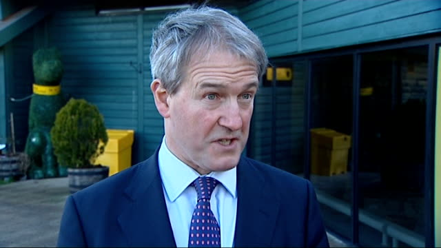 dogs in england must be microchipped from 2016 gvs dog microchipped and owen paterson interview more of microchip held in hand owen paterson... - オーウェン・パターソン点の映像素材/bロール