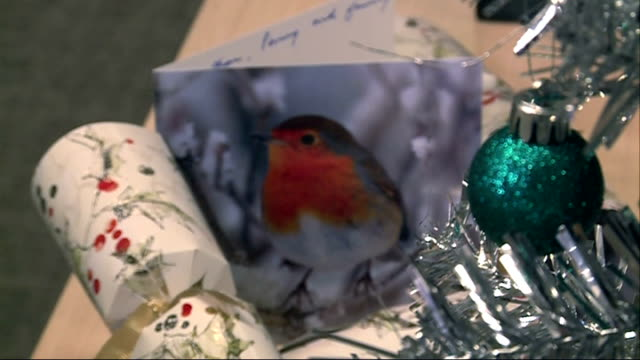 rise in number of robins in london london int christmas tree pull focus christmas card with picture of robin on it and christmas cracker - christmas cracker stock videos and b-roll footage