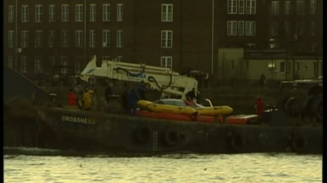 river thames stranded whale 10th anniversary; tx 21.1.2006 barge carrying whale along river thames - barge stock videos & royalty-free footage