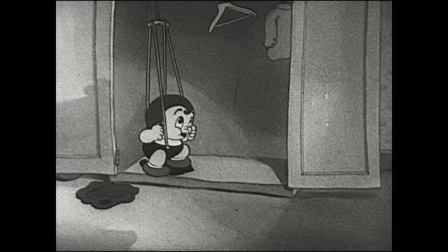 vidéos et rushes de animated boy acrobatically jumps into pants in closet by using hanger to flip into pants - rangement