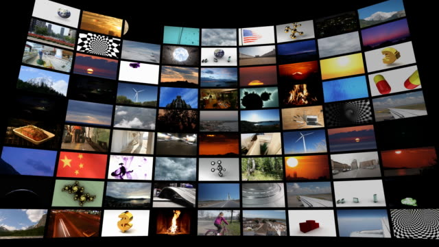 Animated camera into a huge panel of video screens