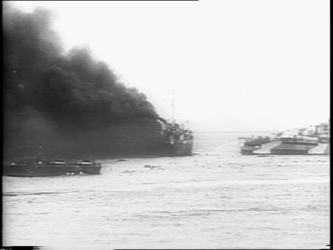 stockvideo's en b-roll-footage met animated map / american convoy headed towards mindoro / japanese planes attacked lst, goes up in flames / soldier explain to filipino family that... - pilot