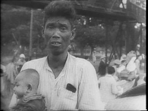 stockvideo's en b-roll-footage met animated map with line from japan to rangoon and burma road / trolley moving through street / montage of battle aftermath wreckage / aerial view of... - 1942