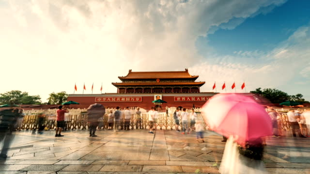 animated picture with cinemagraph effect of people who open an umbrella in front of tiananmen gate, gate of heavenly peace, beijing, china - tiananmen square stock videos and b-roll footage