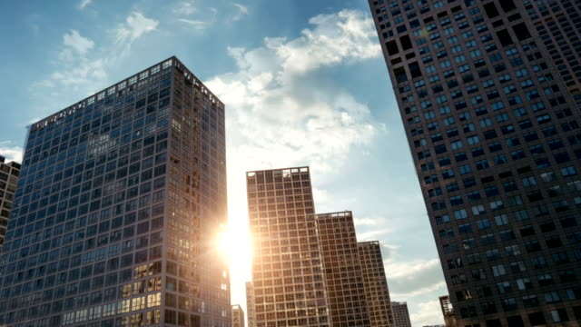 animated picture with cinemagraph effect of skyscrapers in sunlight - skyscraper stock videos & royalty-free footage