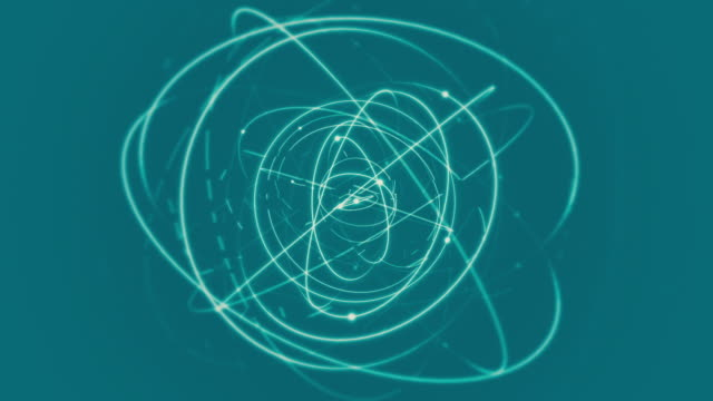 animation atom with nucleus and electrons spinning around it - atom stock videos & royalty-free footage