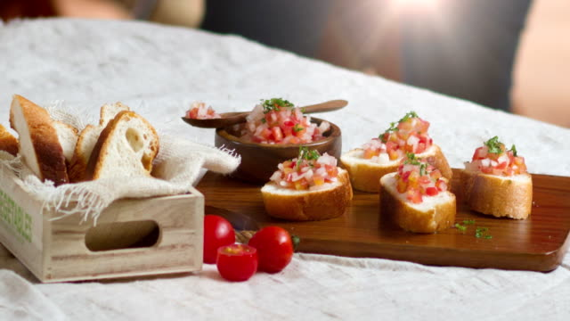 2.5d animation delicious vegetarian appetizer of bruschetta with tomatoes. - chopped food stock videos and b-roll footage