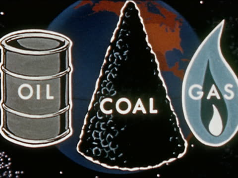 1962 animation earth turning with oil drum, coal pile, and natural gas flame in front / oil, coal, gas zoom in toward earth  / audio - 石炭点の映像素材/bロール