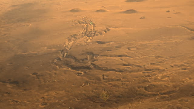 3d animation of a flight over craters and canyons on mars - meteor crater stock videos & royalty-free footage