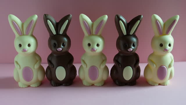 animation of easter bunnies meeting up, standing in a row and walking off. - medium group of objects stock videos & royalty-free footage