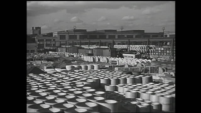animation of large factory appearing on the map of u.s., emitting dotted lines connecting u.s. cities; large cargo truck passing through large... - 1940 1949 stock-videos und b-roll-filmmaterial