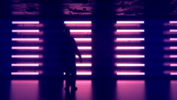 4K animation of man standing in front of a futuristic wall.