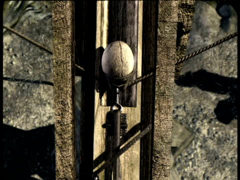 Animation of Roman soldiers firing stone ball from catapult