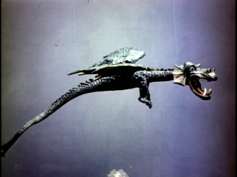 1951 MONTAGE Animation of squire killing dragon at castle