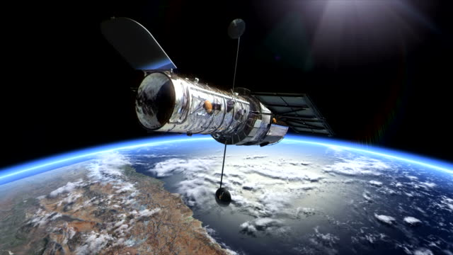 3d animation showing the hubble space telescope over the earth - sternenteleskop stock-videos und b-roll-filmmaterial