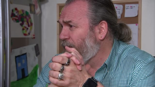 animator's sketches to cope with grief providing support to thousands; england: int gary andrews interview with reporter sot - animator stock videos & royalty-free footage