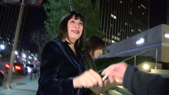 anjelica huston greets a fan while arriving at a private cocktail party in century city 01/12/13 - anjelica huston stock videos & royalty-free footage