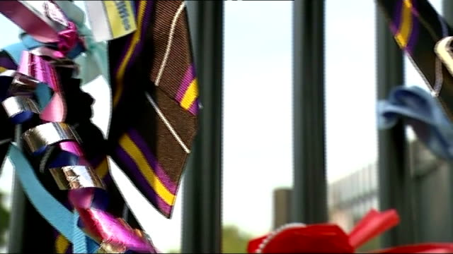 Student admits to killing ENGLAND Leeds Corpus Christi Catholic College EXT Close Shot of school ties and ribbon tributes Close Shot of tribute...
