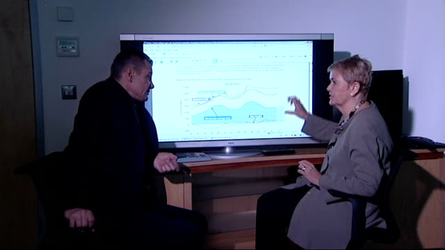 stockvideo's en b-roll-footage met ann robinson interview sot cutaway robinson looking at graph on screen showing margin between what energy companies pay for energy and customers - graph