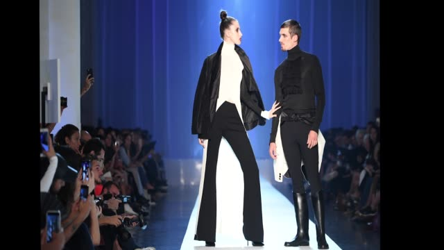 Anna Cleveland and a male model walk the runway during the JeanPaul Gaultier Haute Couture Fall Winter 2018/2019 show as part of Paris Fashion Week...