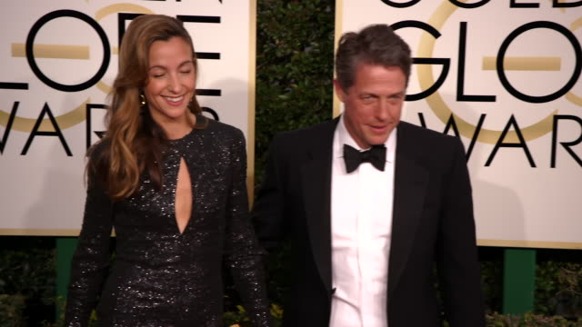 anna elisabet eberstein and hugh grant at the 74th annual golden globe awards arrivals at the beverly hilton hotel on january 08 2017 in beverly... - ビバリーヒルトンホテル点の映像素材/bロール