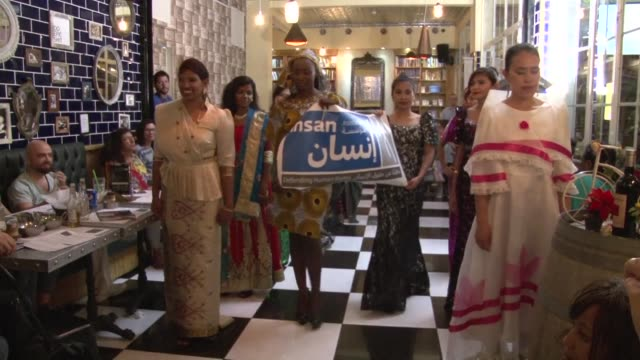 anna fernando struts down the black and white tiles of a trendy coffee shop in the lebanese capital dressed in high heels and a strapless ball gown... - strapless stock videos & royalty-free footage