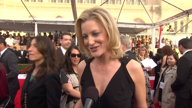 INTERVIEW Anna Gunn on who designed her dress what it means to her to celebrate with her peers her favorite moment at the SAG Awards over the years...