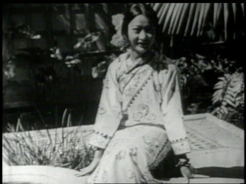 Anna May Wong in a garden